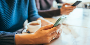 36184744 - two people using smart phones in cafe