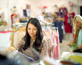 RFID-asian-woman-shopping-clothes-retail